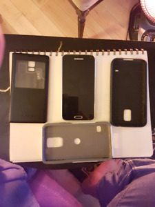 Selling Unlocked Samsung 5 with 4 phone cases
