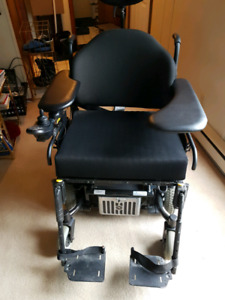 QUICKIE  EXCEL POWERED WHEEL CHAIR