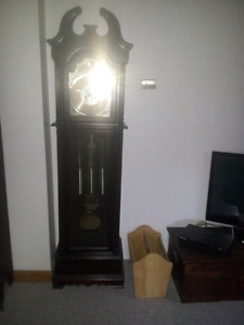 Grandfather clock and.multi china  cabinet and desk combo