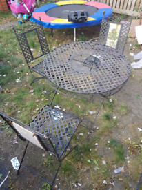 Cast iron folding table and chairs
