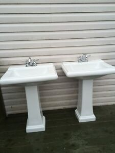 Two Foremost pedestal sinks with chrome faucets