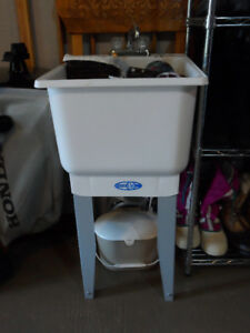 New small laundry tub with fawcet