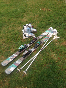 GENTLY USED WOMEN'S SKIS, POLES, and BOOTS