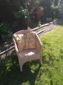 Wicker cane chair and feather cushion