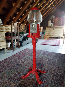 Red metal antique gumball machine