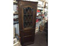 Fantastic vintage solid wood leaded window corner cabinet can deliver