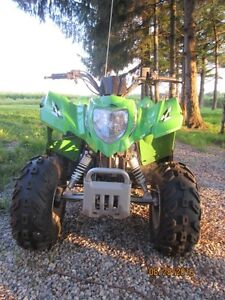 ARCTIC CAT DXV 50.  It's a fun as it's lime green colour