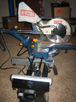 Ryobi 10 inch Sliding Compound Mitre Saw with laser on stand.