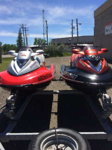 Pair of Seadoos: 3 passenger with double trailer and covers.