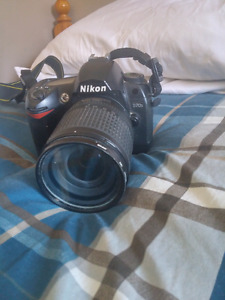 Nikon D70s (looking for canon stuff)