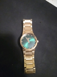 Nixon Gold and Green watch