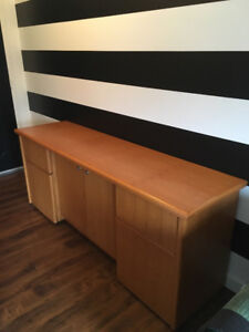 Solid oak credenza with drawers and a cupboard.