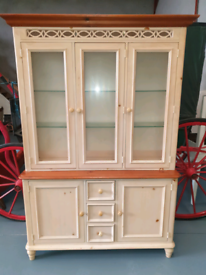 Cream pine kitchen display unit with spot lights