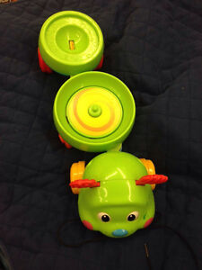 Rolling spinning catapillar toy