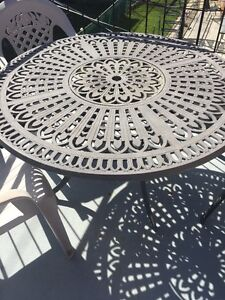 PATIO TABLE WITH 4 CHAIRS $50.00