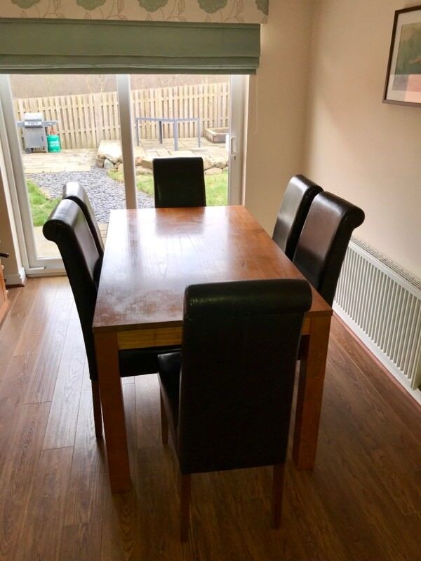 Dark Wood Dining Table And 6 Leather Chairs