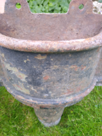 Cast iron rainwater hoppers.