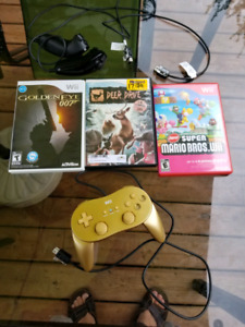 Wii games and controller and 2 chuks