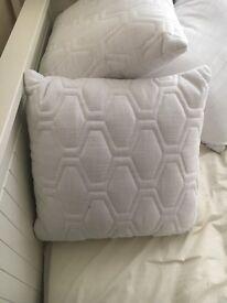 White sofa cushions