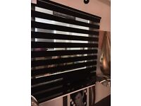 Black vision blinds with white furnishings