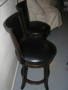 Pair of wooden swivel counter stools