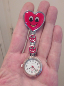 NURSE, CAREGIVER BRAND NEW RED SMILEY FACE CLIP ON POCKET WATCH.