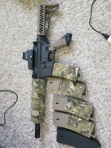 custom Tippman tmc with tactical vest and limited edition mask