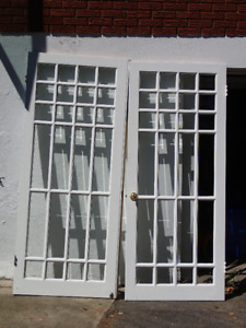 Antique solid wood and glass doors to sell.