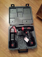 12-volt electric power drill and worklight