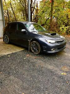 2010 Subaru Sti avec extra