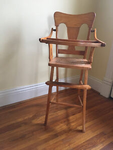 Wooden high chair with caned seat