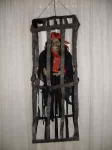HALLOWEEN ANIMATED PIRATE IN CAGE