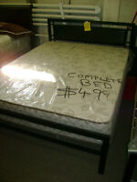 Complete new queen size bed with mattress. $499.