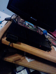 Playstation 2 ( 1 remote and 3 games ) West Island Greater Montréal image 1