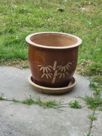 Large ceramic pot and saucer