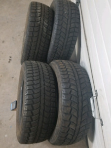 (4) 215/65/16 Uniroyal winter tires