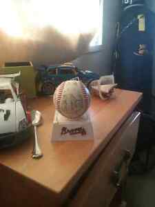 Signed braves baseball with stand