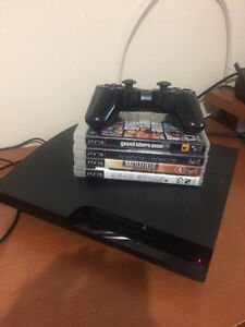 PS3 WITH 4 Games
