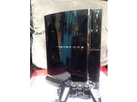 PlayStation 3 60gb + controller/stand/wires