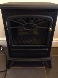 Electric cast iron fire effect heater