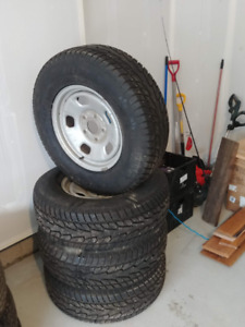 265/70 R17 Winter Tires (on Silver Rims)