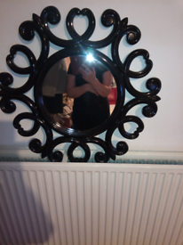 Black ornate mirror very nice style not very heavy