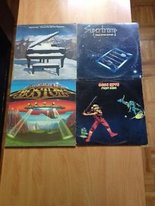 Vinyles: genesis, rush, motley crue, supertramp, santana, boston