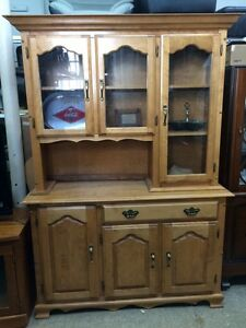 Honey color china cabinet