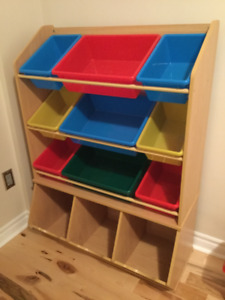 Storage shelf with built in bins at bottom and removable buckets