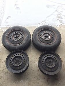 """(4) 15"""" rims with 2 almost brand new winter tires"""