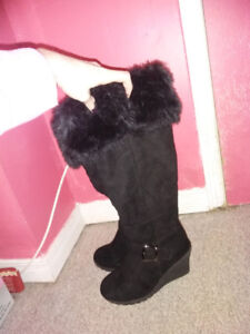 Brand new. Black women's boots size 6