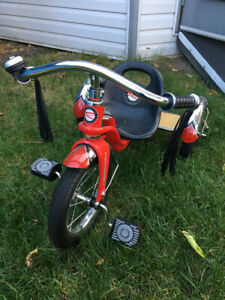 Tricycle rouge excellente condition