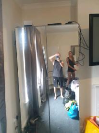 Mirrored wardrobe with light