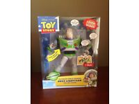 Buzz lightyear deluxe talking figure with box, batteries